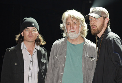 Image of Dan Grimm with John McEuen and Jonathan McEuen backstage at the Grand Ol Opry